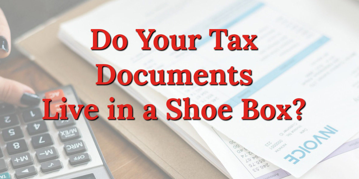 a stack of papers and calculator with text that reads, do your tax documents live in a shoe box?
