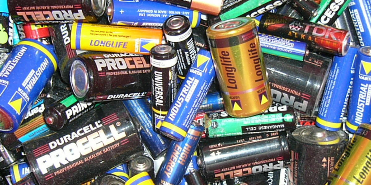 a messy pile of batteries