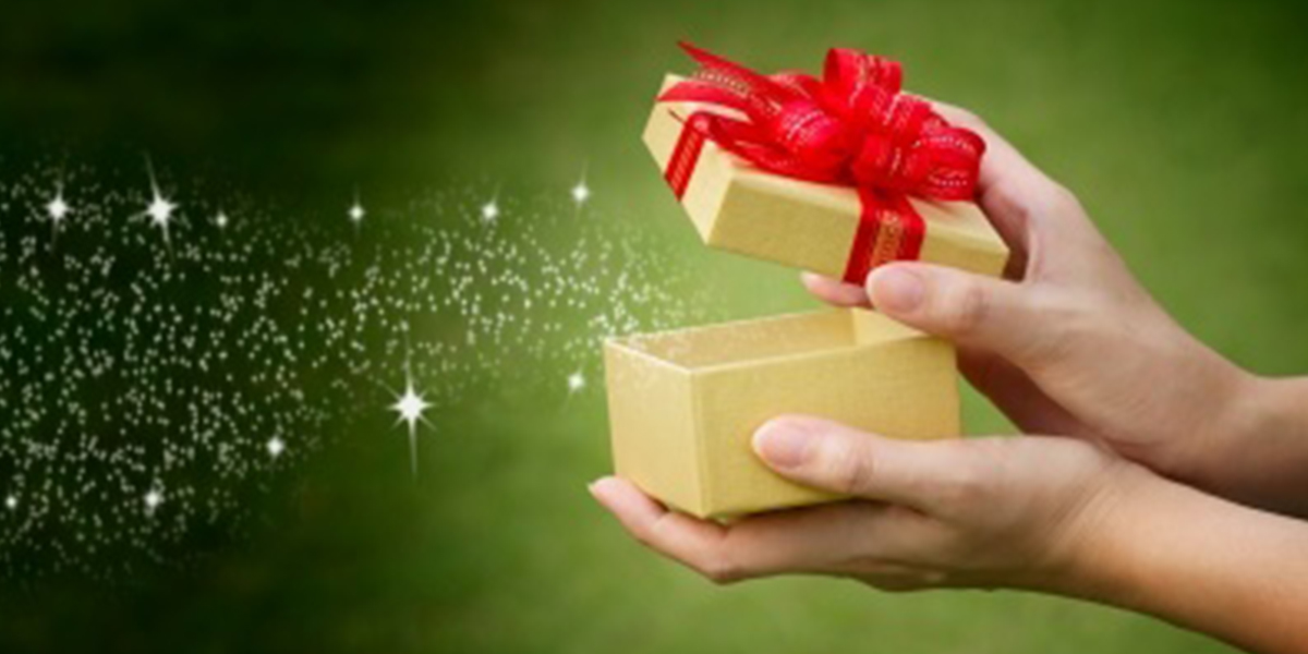 a gift box open with magic sparkles coming out