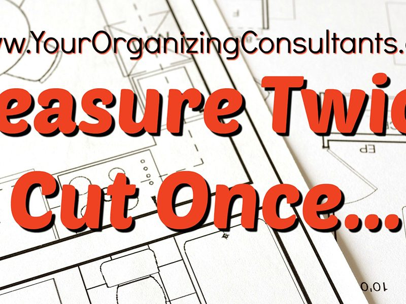 construction plans open and text that reads, measure twice, cut once