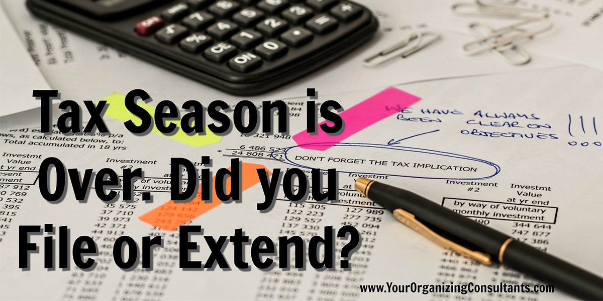 a financial document with writing on it, next to a pen and a calculator with text that reads, tax season is over. Did you file or extend?