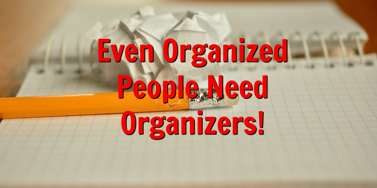 an open notebook with a pencil and a crumbled piece of paper with text that reads, even organized people need organizers