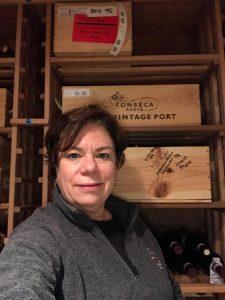 Anna organizing wine cellar
