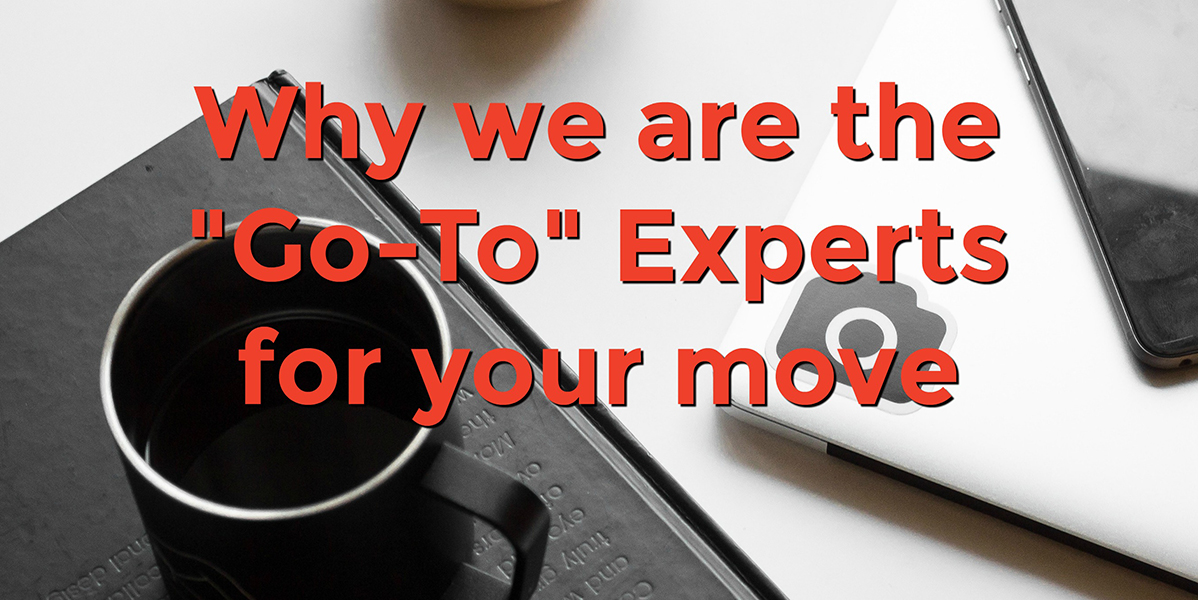 a table surface with a book, coffee cup and phone with text that reads, why we are the go-to experts for your move