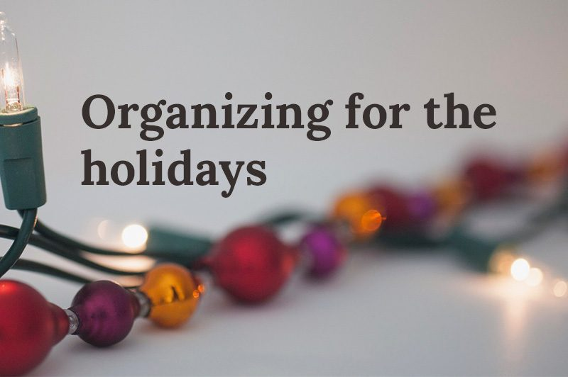 holiday lights with text that reads, organizing for the holidays